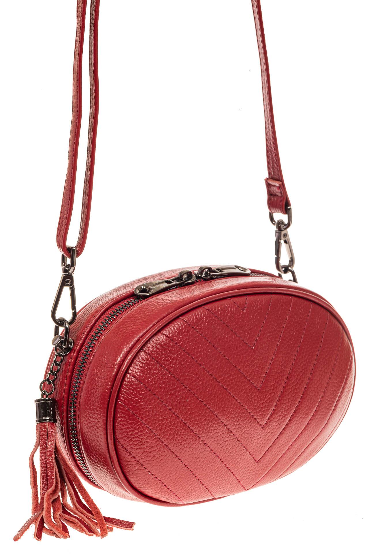 На фото 1 - Круглая сумка-малышка из натуральной кожи, цвет красный