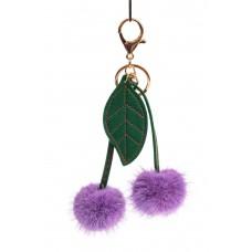 На фото 1 - Сувенирный брелок из натурального меха фиолетового цвета