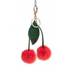 На фото 1 - Брелок-сувенир из натурального меха красного цвета