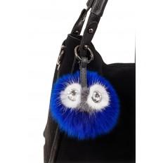 На фото 2 - Брелок с изображением мордочки из натурального меха синего цвета