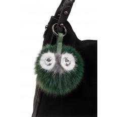 На фото 2 - Брелок из натурального меха зеленого цвета