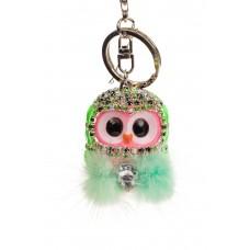 На фото 1 - Брелок в форме совы мягкой игрушки зеленого цвета