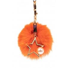 На фото 1 - Брелок из натурального меха оранжевого цвета