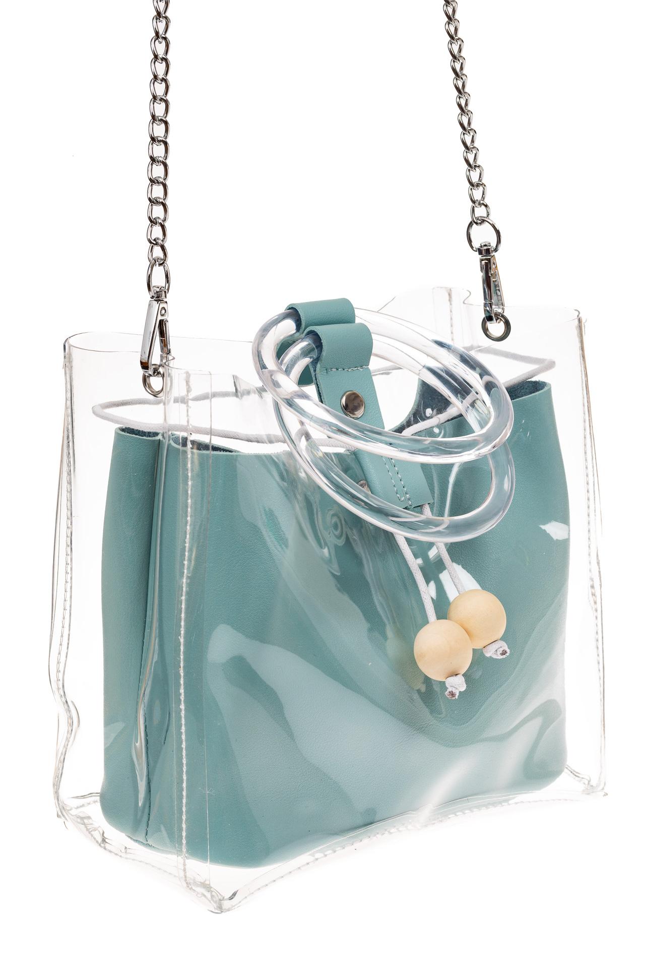 На фото 1 - Ring-bag из винила и эко-кожи, цвет голубой