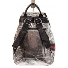 На фото 3 - Серебристый рюкзак из искусственной кожи грушевидной формы