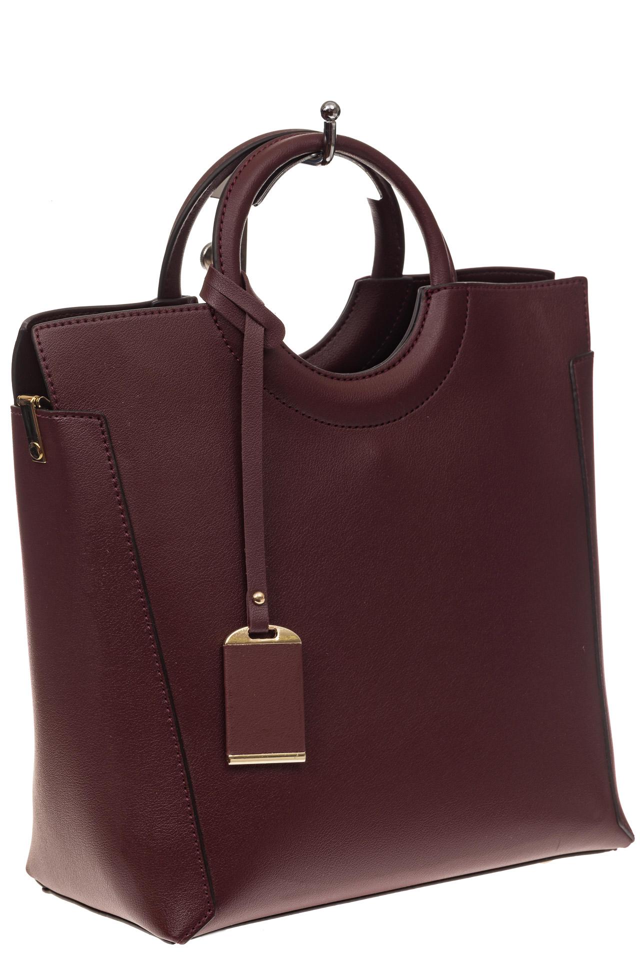 На фото 1 - Бордовая сумка с ручками-кольцами из искусственной кожи