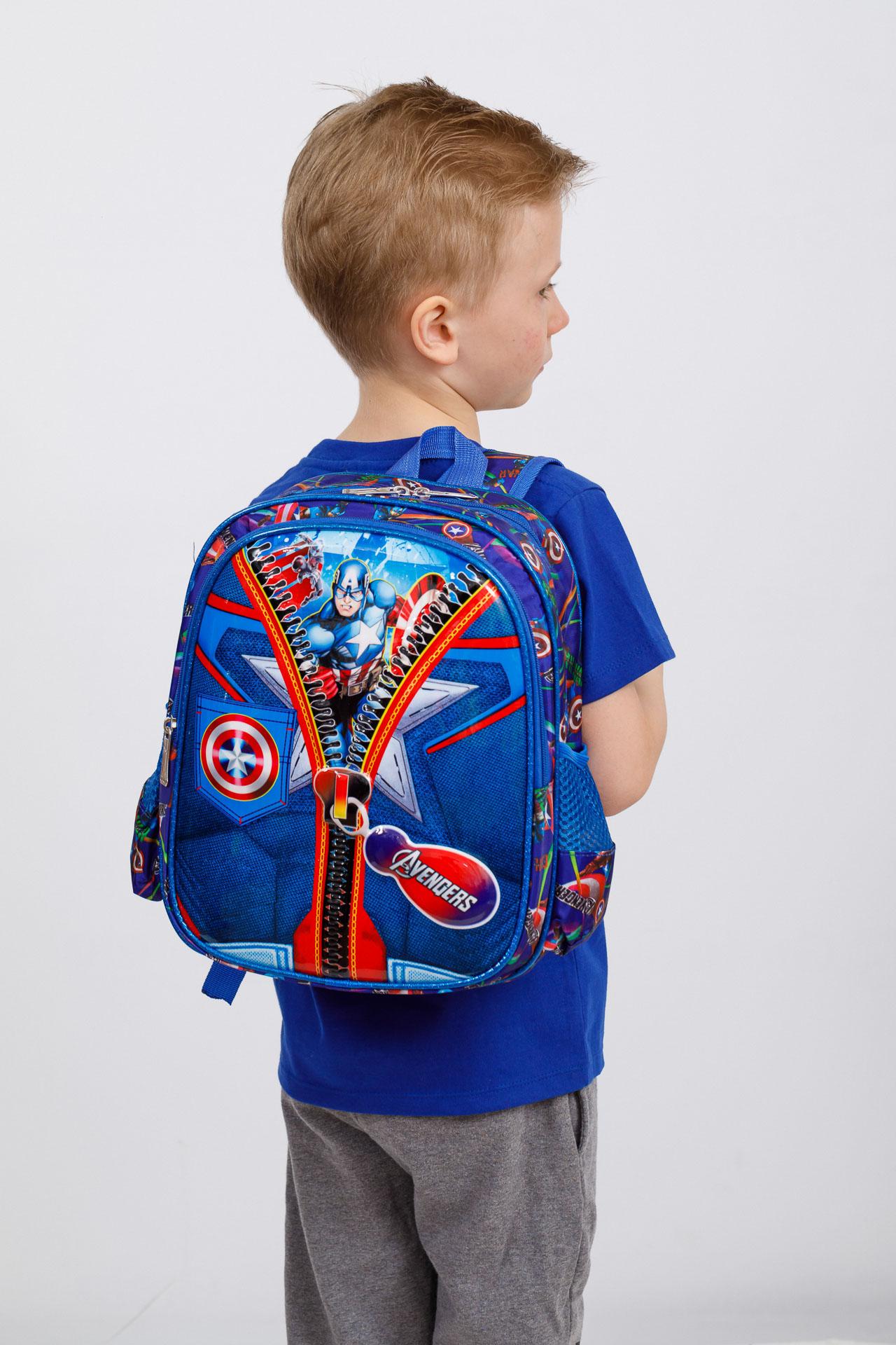 На фото 4 - Детский рюкзак из текстиля с ярким принтом, цвет синий