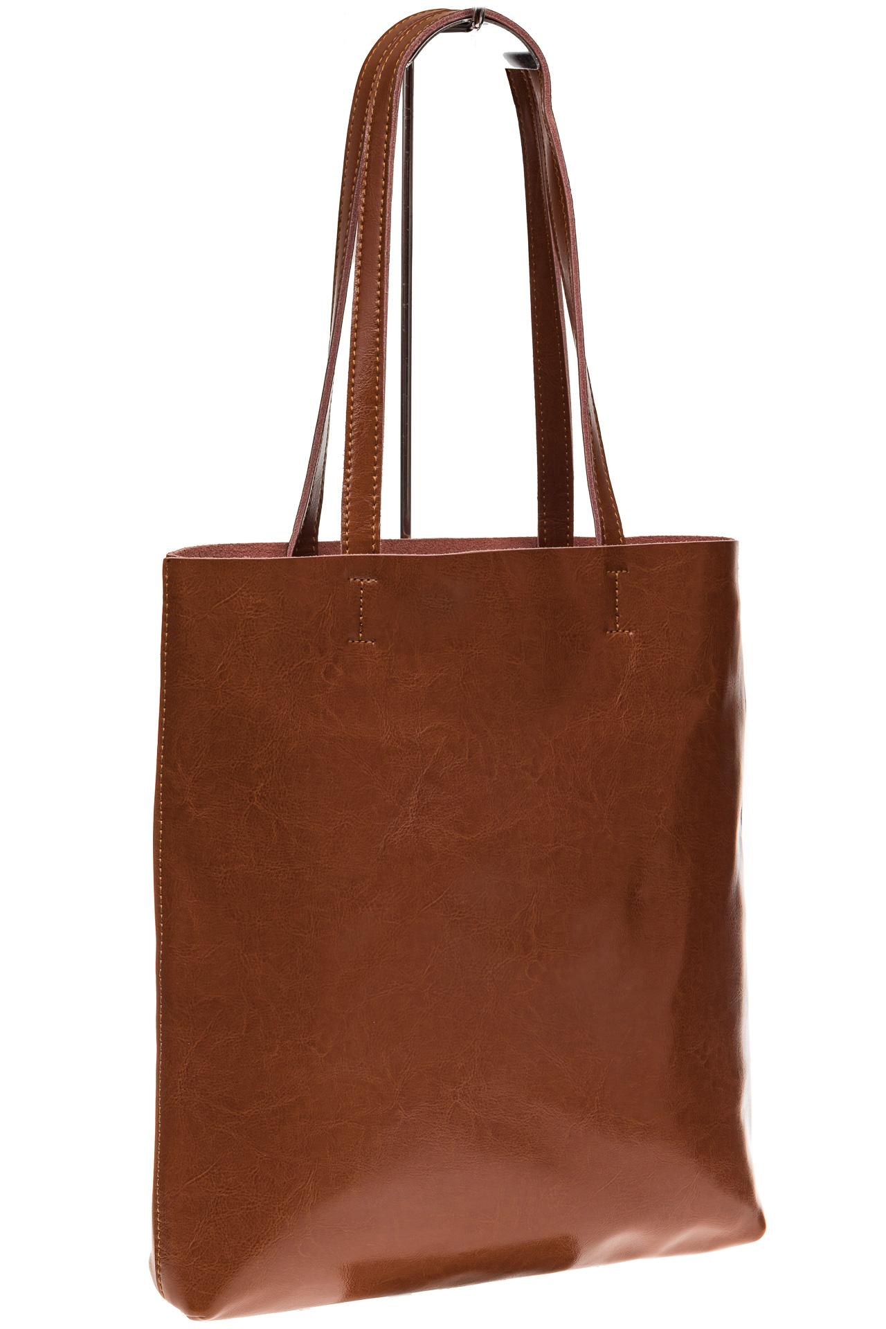 На фото 1 - Кожаная сумка-пакет рыжего цвета