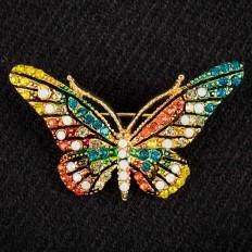 На фото 2 - Брошь в форме бабочки со стразами