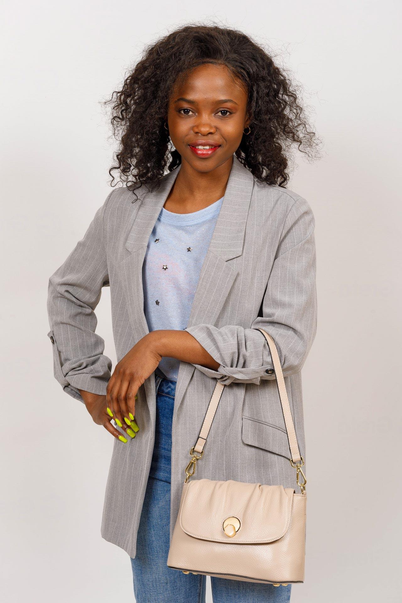 На фото 5 - Маленькая женская сумка с замком-вертушкой, цвет бирюзовый