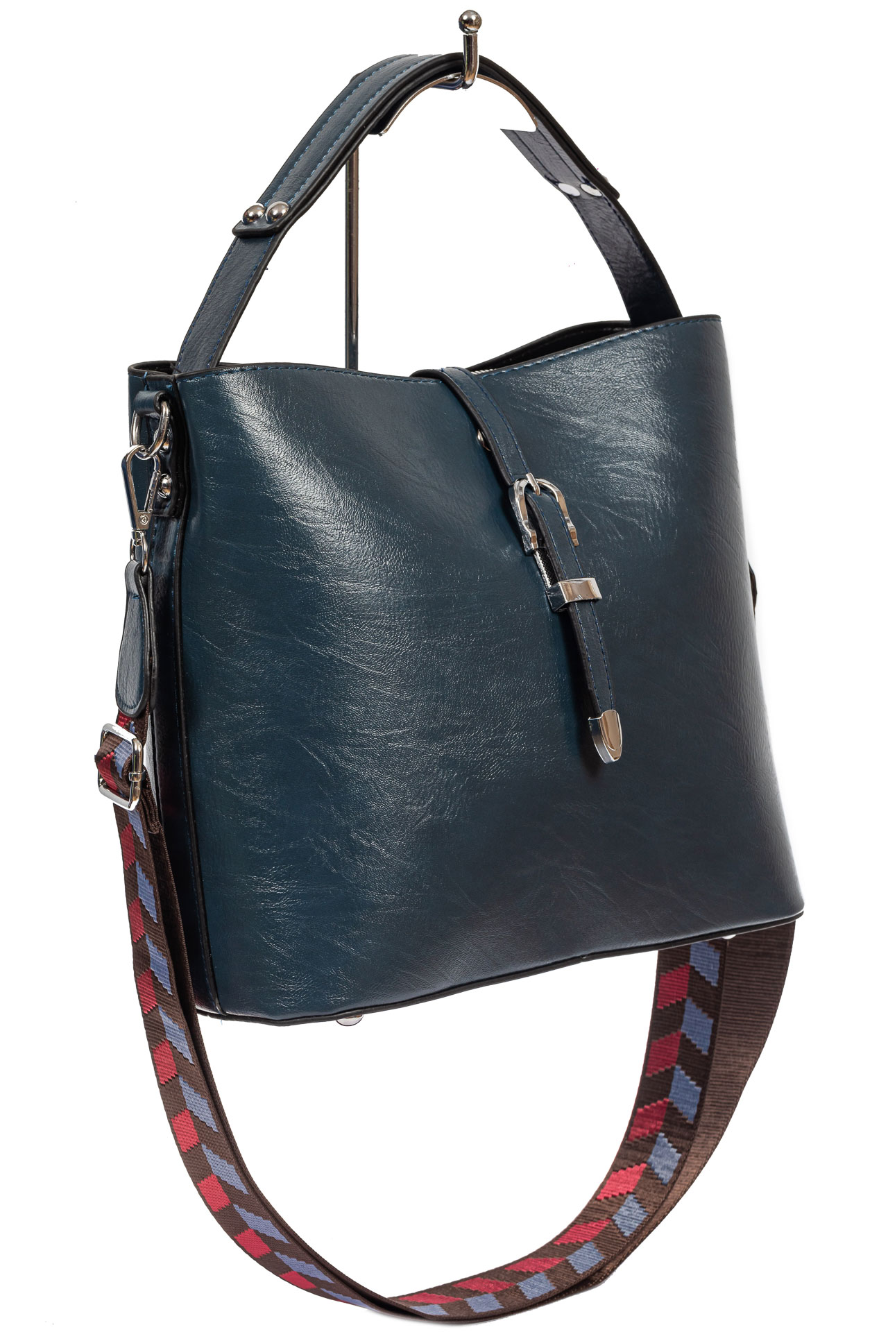 На фото 1 - Женская сумка-бочонок из искусственной кожи, цвет синий
