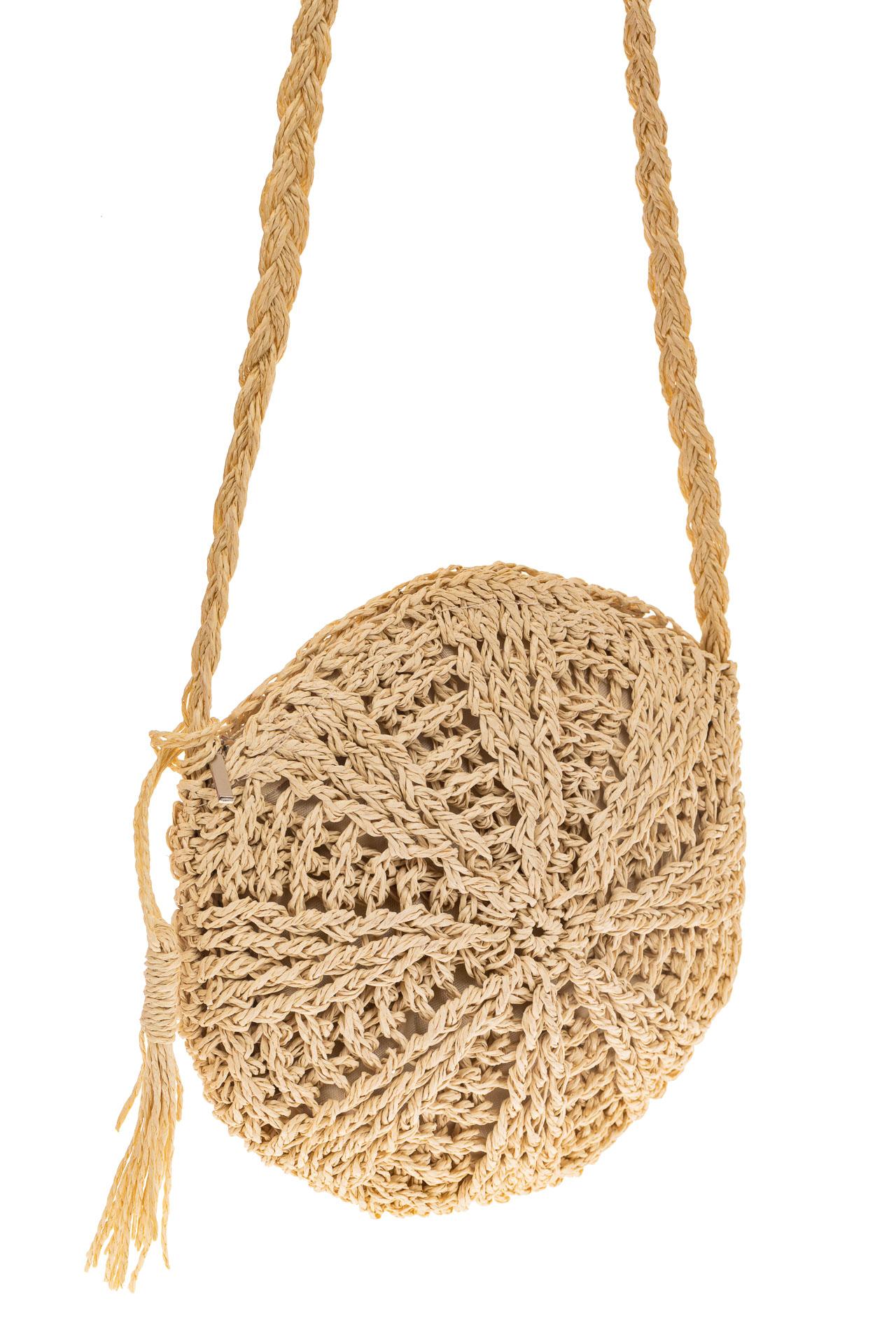 На фото 1 - Круглая плетеная женская сумка из джута, цвет светло-бежевый