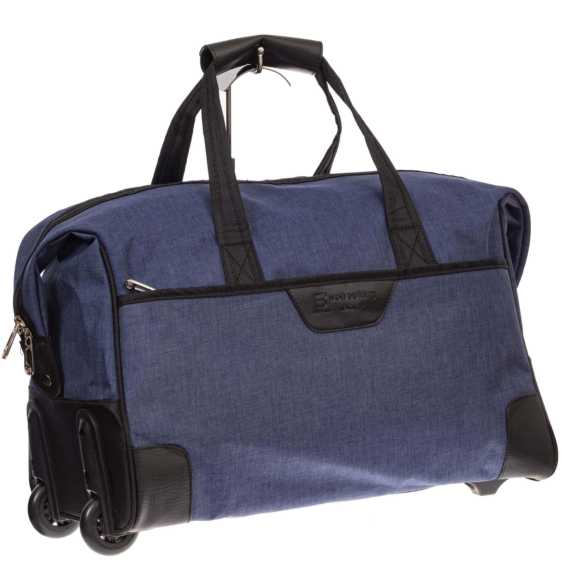 На фото 1 - Дорожная сумка на колесиках, цвет синий