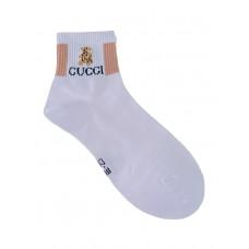 На фото 1 - Женские носки с резинкой и принтом, цвет белый