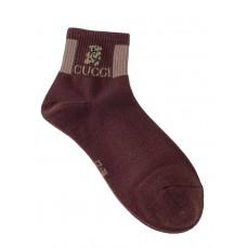 На фото 1 - Женские носки с резинкой и принтом, цвет коричневый