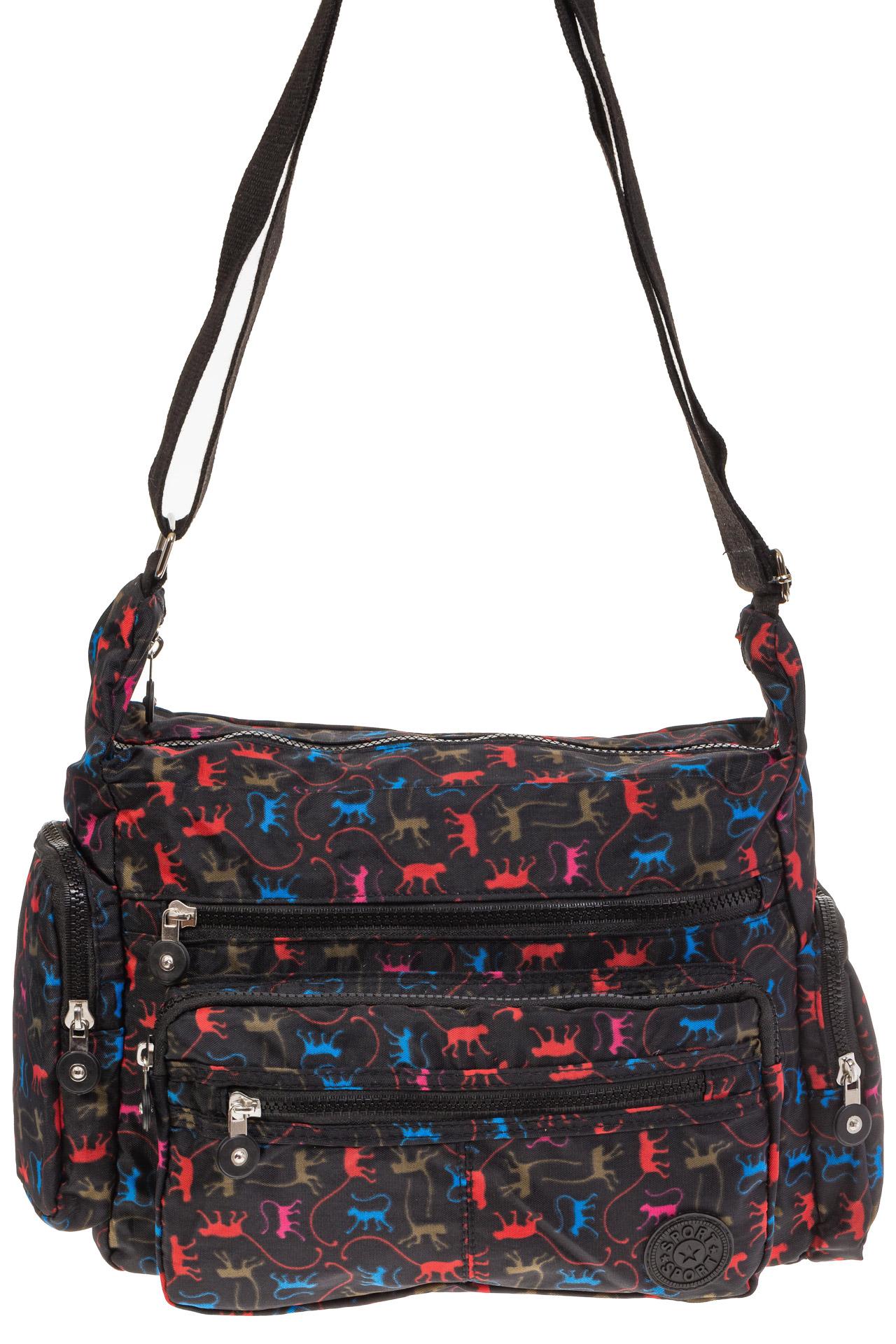 На фото 2 - Текстильная темная сумка с ярким принтом