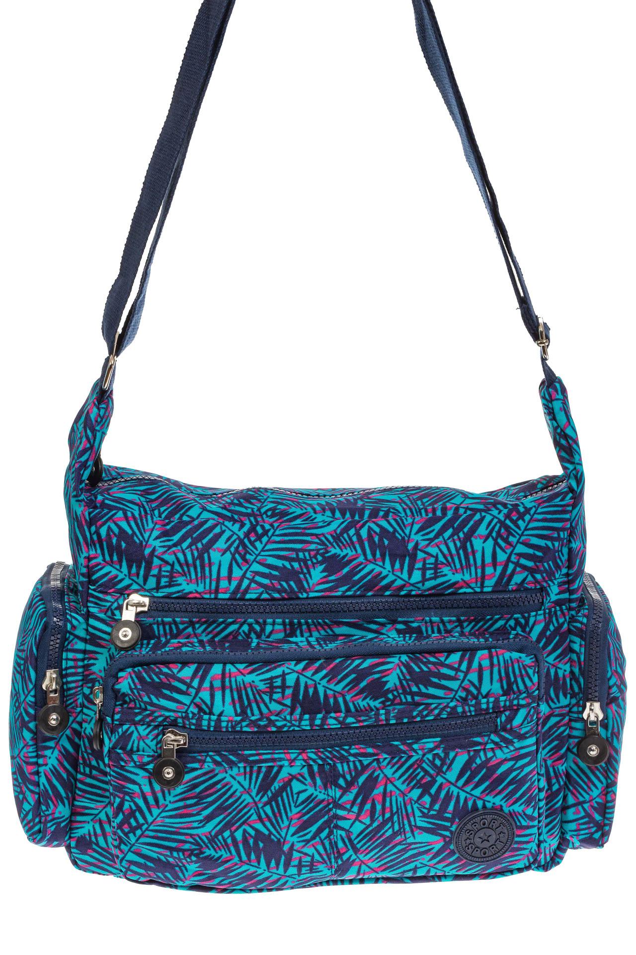 На фото 2 - Текстильная темная сумка с растительным принтом