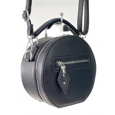 На фото 1 - Круглая женская сумочка из искусственной кожи, цвет чёрный