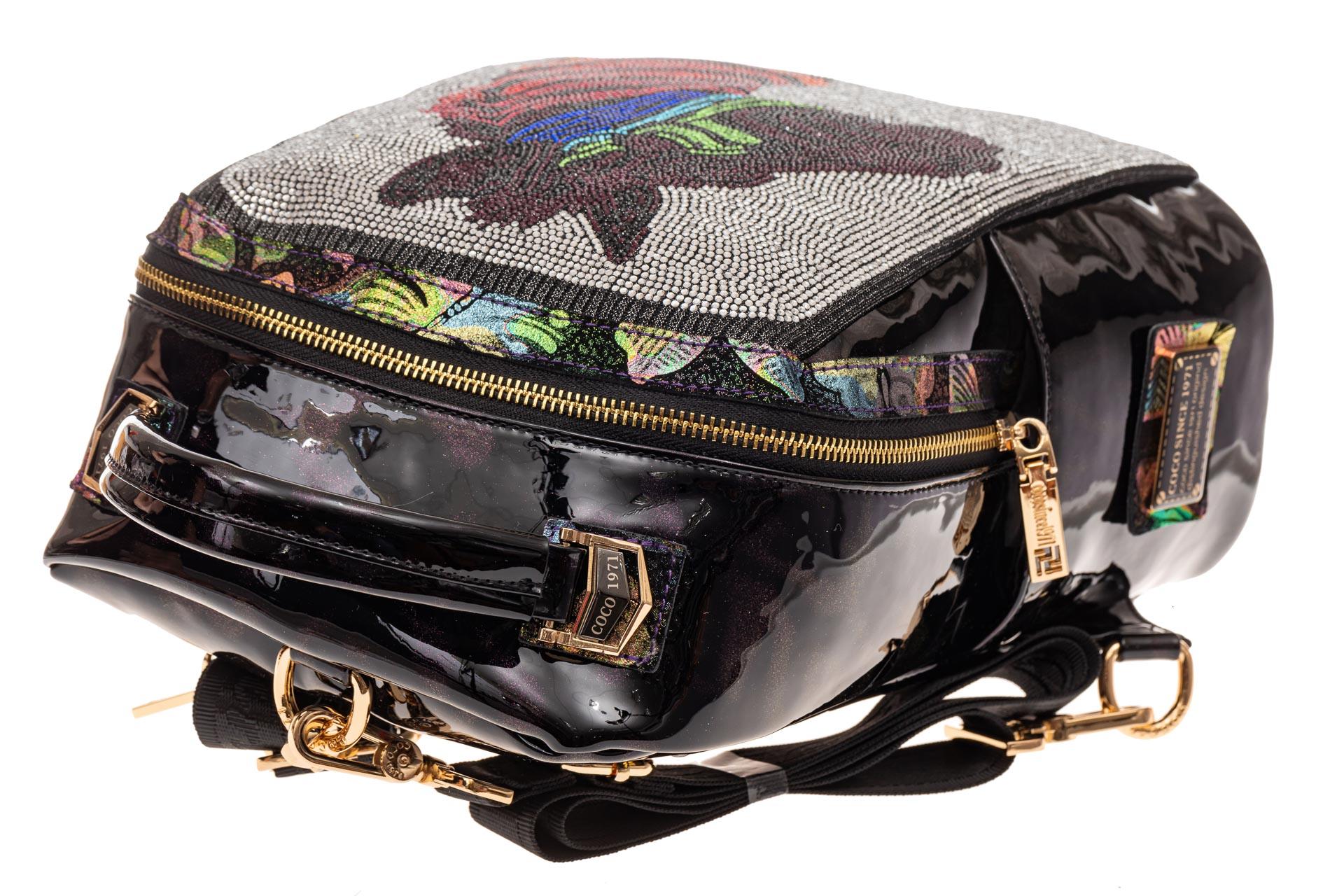 На фото 4 - Женский рюкзак из кожи со стразами, цвет фиолетовый