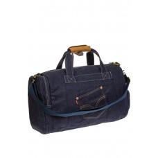 На фото 1 - Большая джинсовая сумка фирменного синего цвета