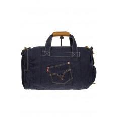 На фото 2 - Большая джинсовая сумка фирменного синего цвета