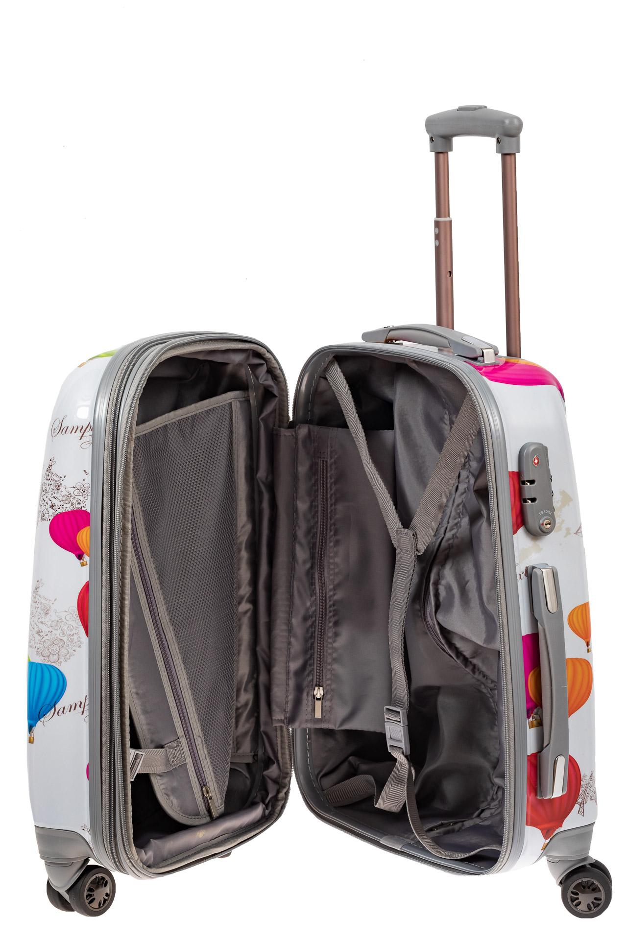 На фото 3 - Небольшой пластиковый чемодан с символами Франции