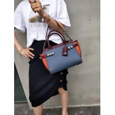 На фото 1 - Кожаная женская сумка-портфель, цвет синий с оранжевым и бордовым
