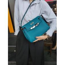 На фото 1 - Кожаная женская сумка-портфель, цвет бирюзово-зеленый