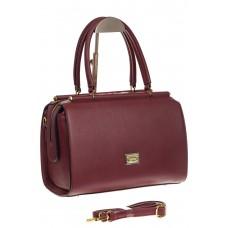 На фото 1 - Строгая женская сумка бордового цвета из эк...