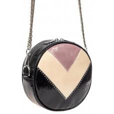 На фото 1 - Женская круглая сумка из экокожи, цвет черный с розовым