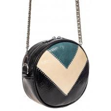 На фото 1 - Женская круглая сумка из экокожи, цвет черный с синим