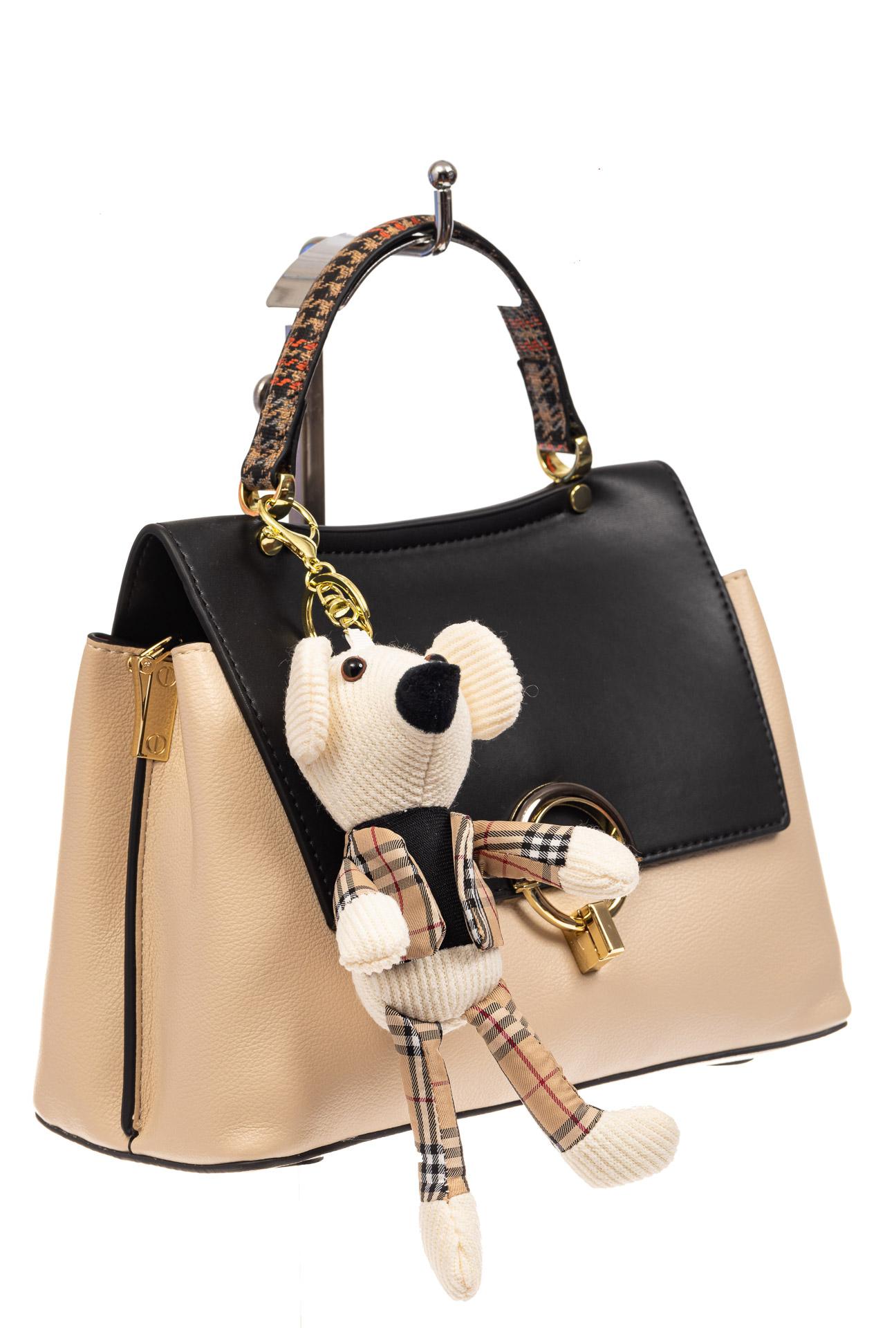 На фото 1 - Классическая сумка-трапеция из кожзама, цвет молочный с черным