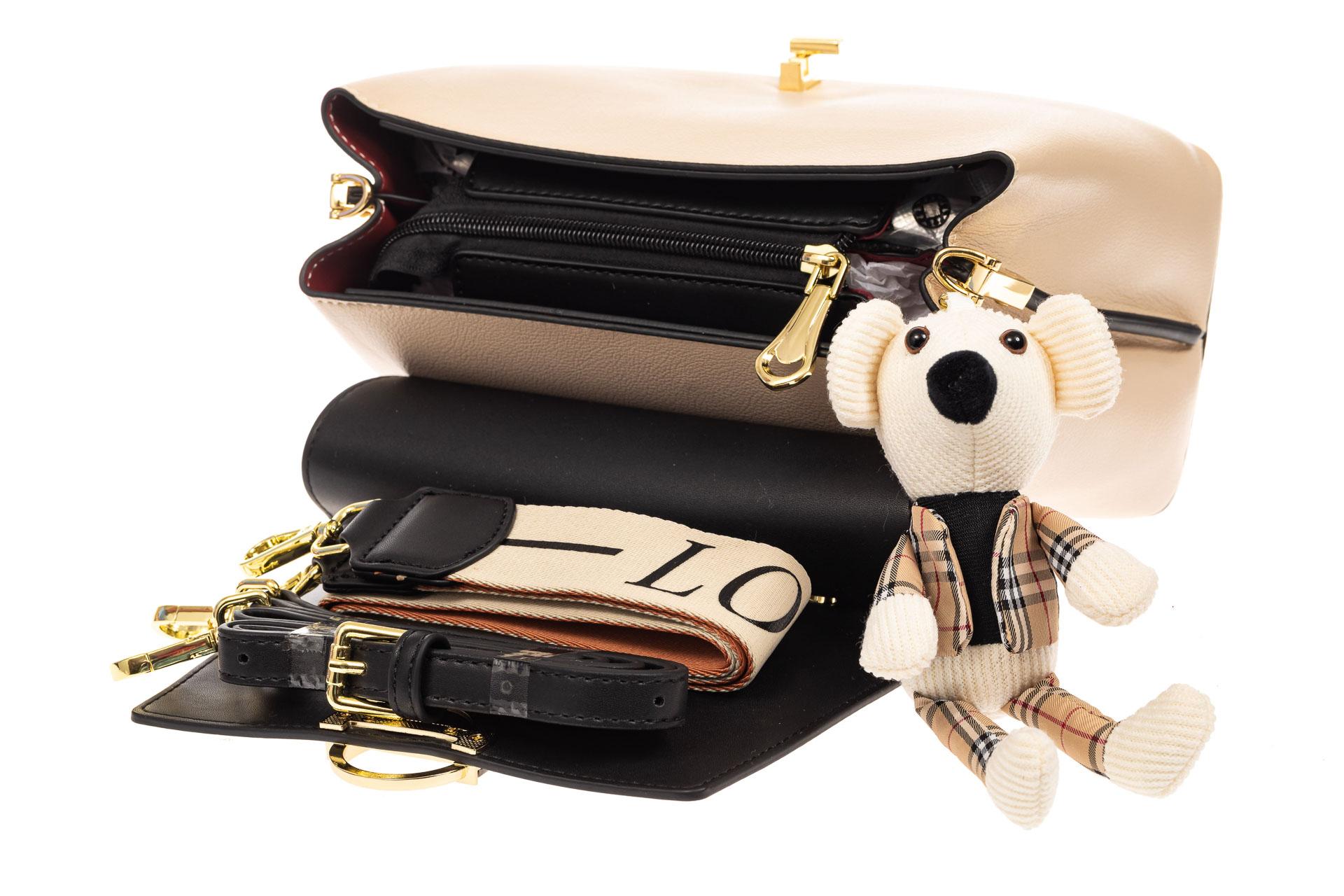На фото 4 - Классическая сумка-трапеция из кожзама, цвет молочный с черным