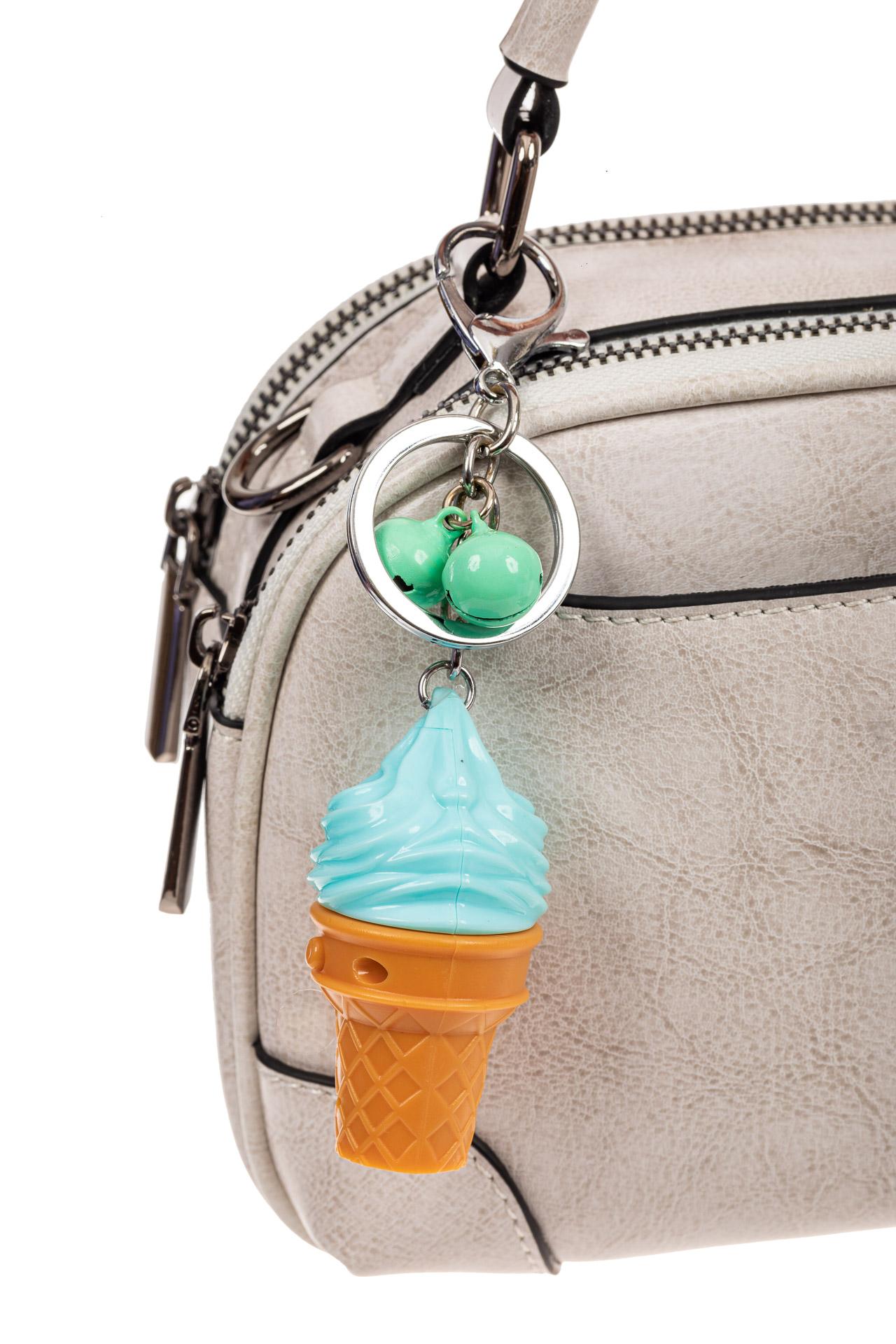 На фото 2 - Свето-музыкальный брелок мороженое, цвет бирюза