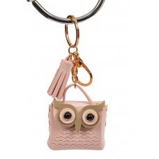 На фото 1 - Брелок в виде сумки-совы из искусственной кожи, цвет розовый