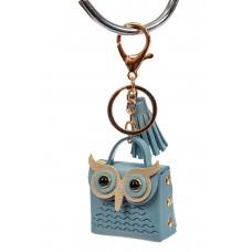 На фото 1 - Брелок в виде сумки-совы из искусственной кожи, цвет голубой