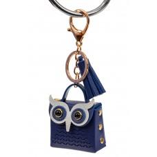 На фото 1 - Брелок в виде сумки-совы из искусственной кожи, цвет синий