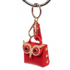На фото 1 - Брелок в виде сумки-совы из искусственной кожи, цвет красный