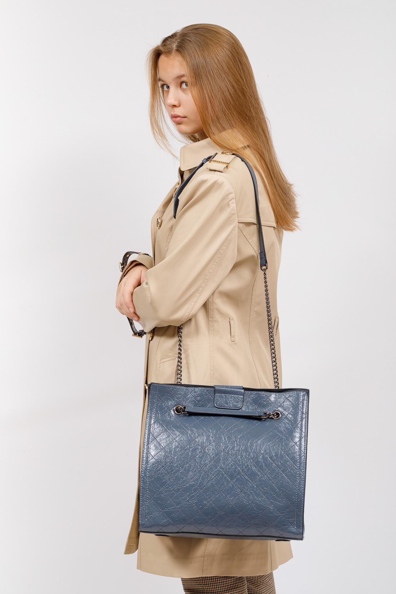 На фото 5 - Стеганая женская сумка из искусственной кожи, цвет голубой