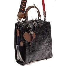 На фото 1 - Сумка женская рюкзак из искусственной кожи с тиснением, цвет черный