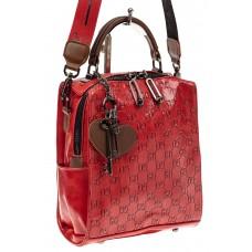 На фото 1 - Сумка женская рюкзак из искусственной кожи с тиснением, цвет красный