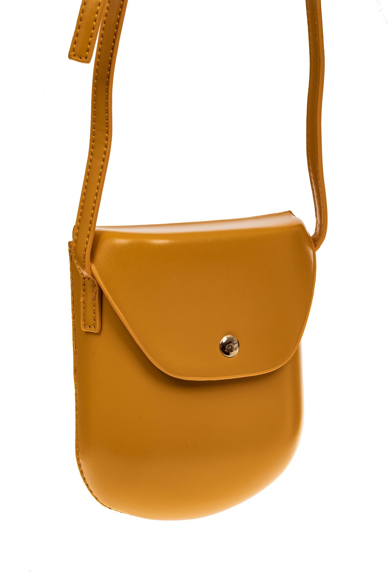 На фото 1 - Женская сумка-кобура из искусственной кожи, цвет горчичный