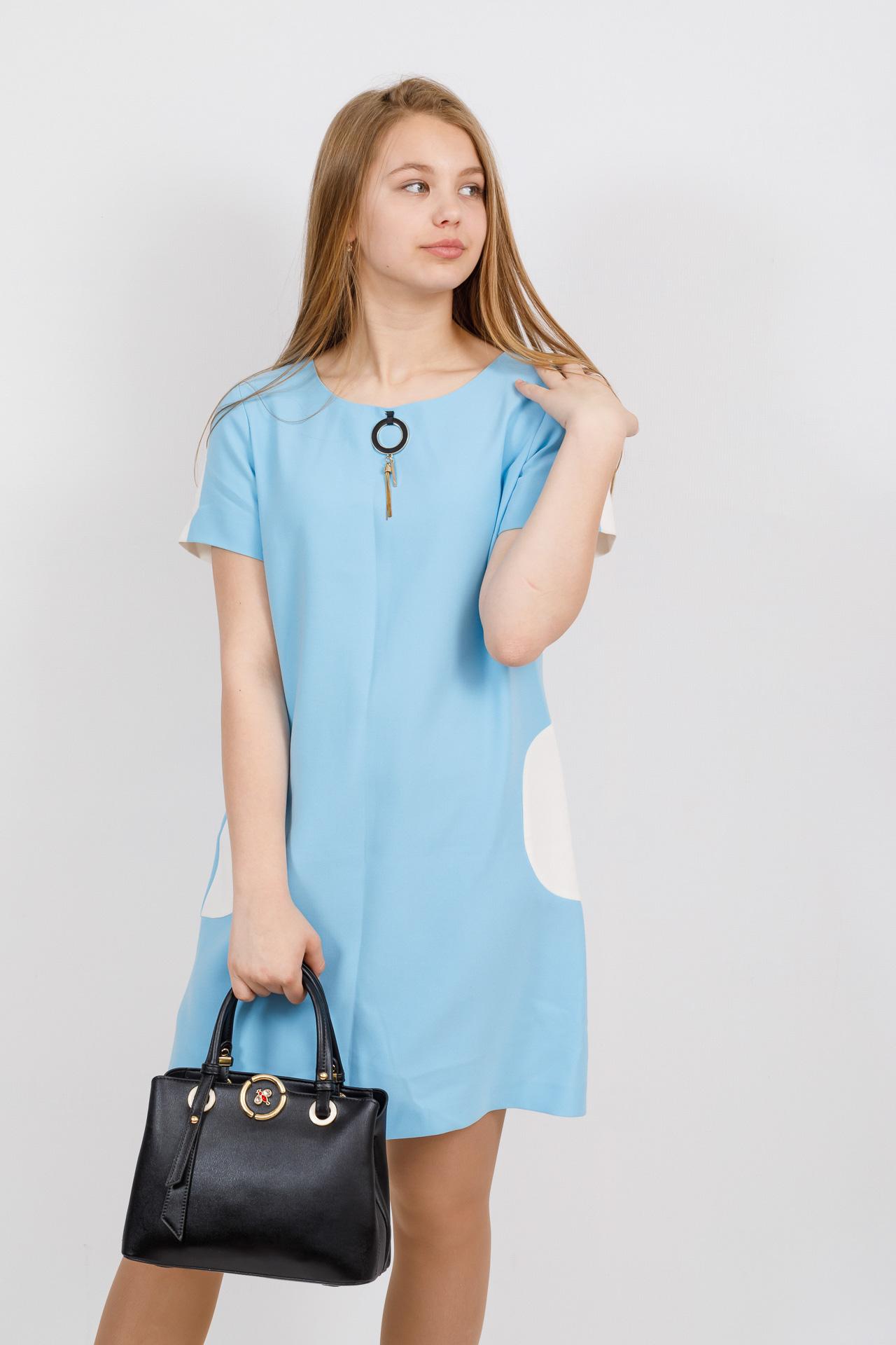 На фото 4 - Классическая женская сумка из искусственной кожи, цвет черный
