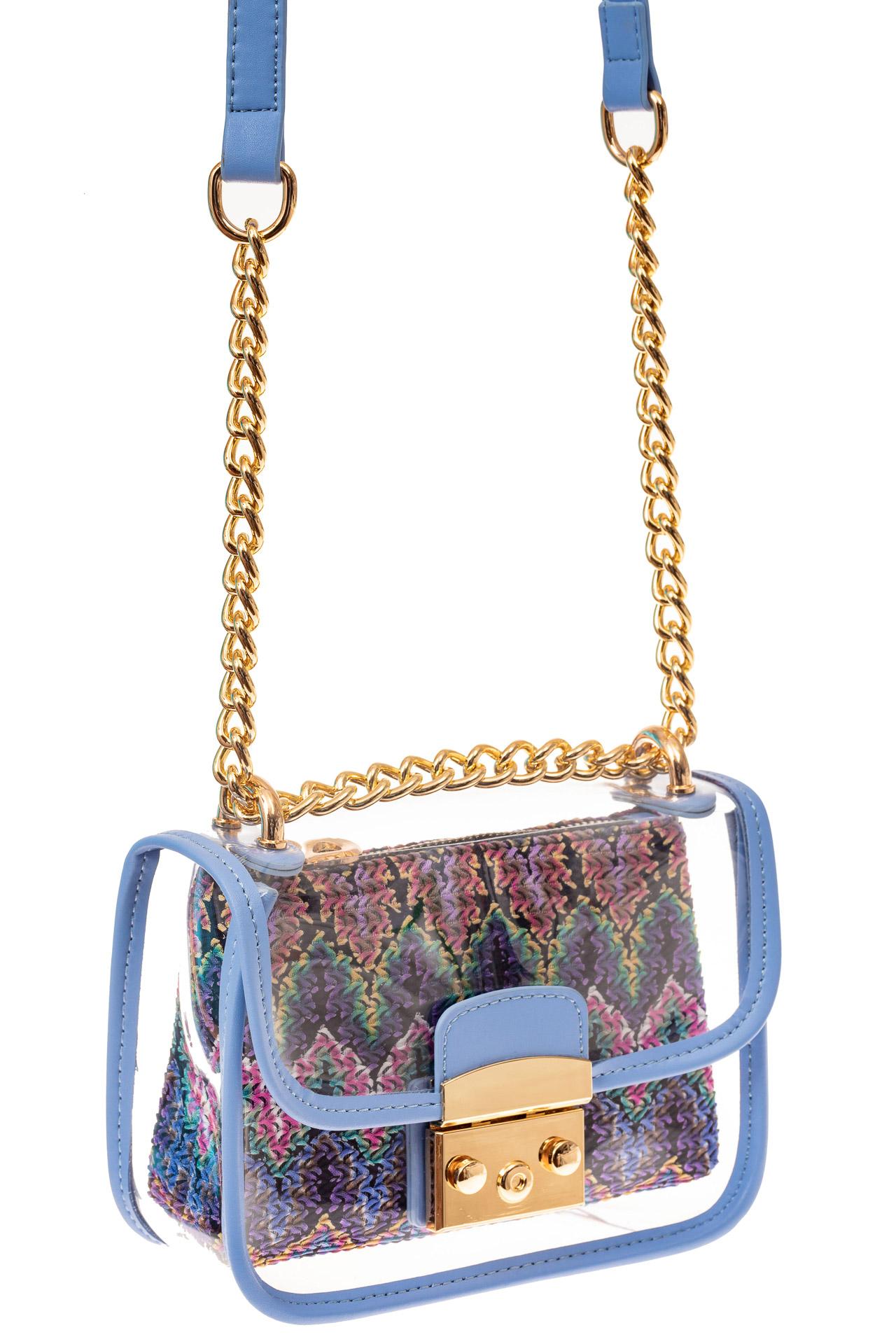 На фото 1 - Прозрачная сумочка с голубой окантовкой