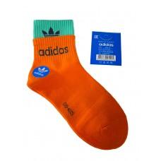 На фото 1 - Женские спортивные носки с манжетами, цвет оранжевый с бирюзовым