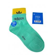 На фото 1 - Женские спортивные носки с манжетами, цвет светло-бирюзовый с жёлтым