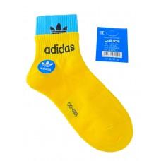 На фото 1 - Женские спортивные носки с манжетами, цвет жёлтый с бирюзовым
